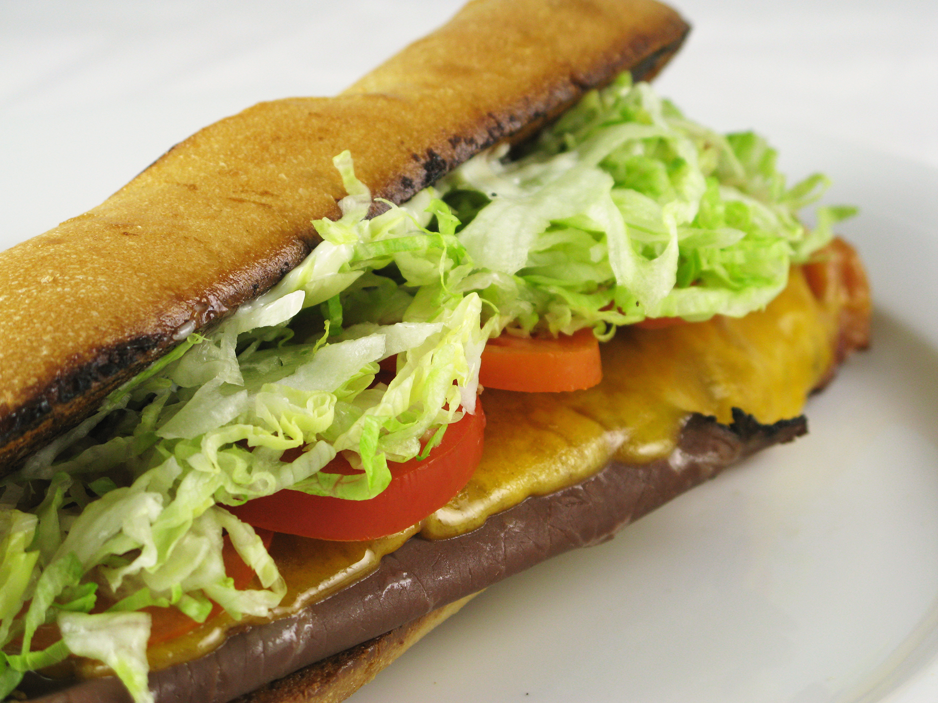 Sub with veggies, cheese, and roast beef